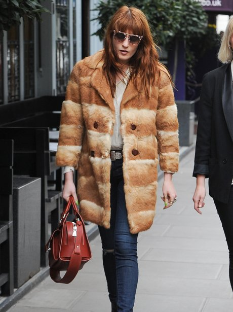Florence Welch wearing a fur coat