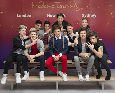 One Direction posing with waxworks at Madame Tussauds