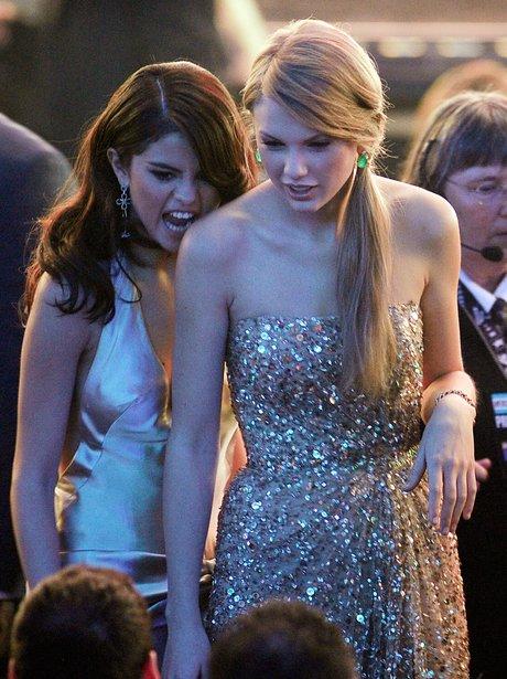 Selena Gomez biting Taylor Swift's shoulder