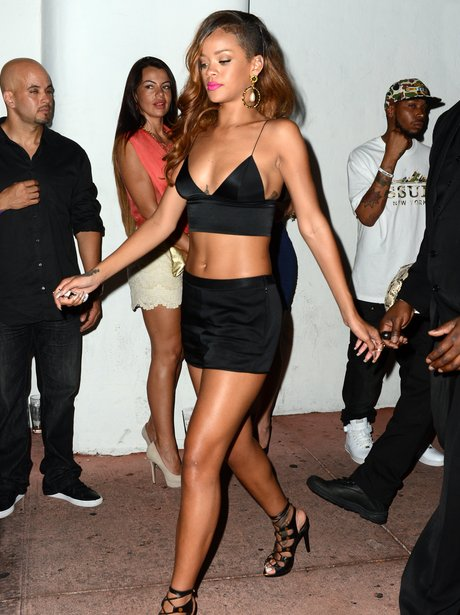 Rihanna in crop top and shorts