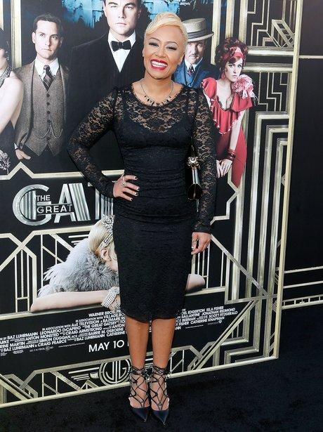 Emeli Sande wearing a lace black dress