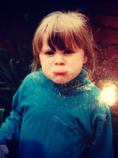 Jessie J with a sad face as a baby