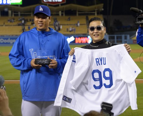 PSY At The Dodgers Match holding t shirt