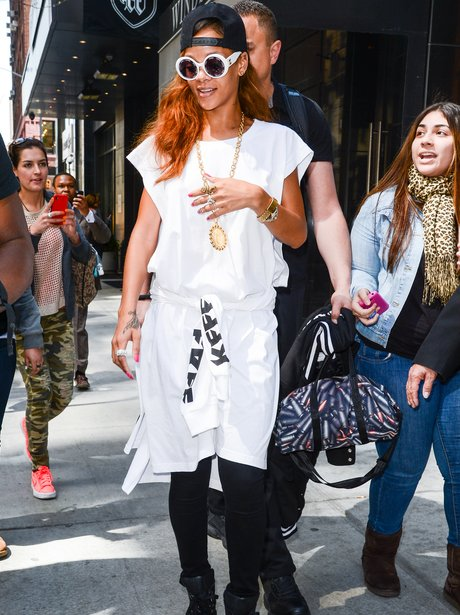 Rihanna wearing a white roman dress