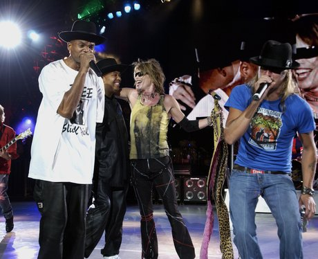 Aerosmith and Run DMC perform on stage together