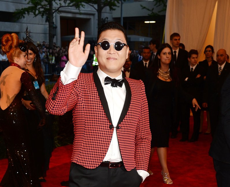 Psy giving the peace sign at Met Gala