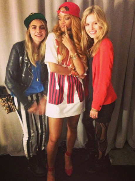 Rihanna poses with Cara Delevingne backstage at a concert