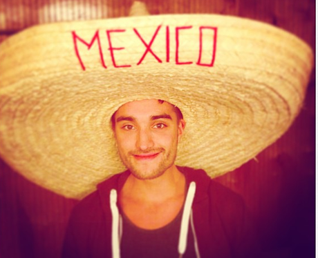 Tom Parker poses with a traditional Mexican hat