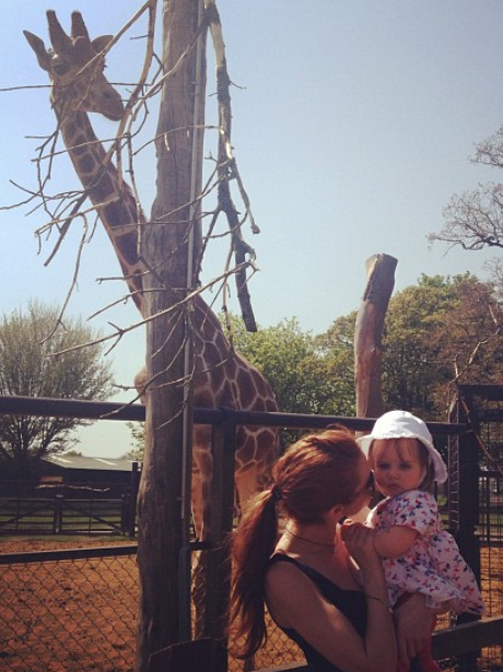 Una Healy is photobombed by a giraffe