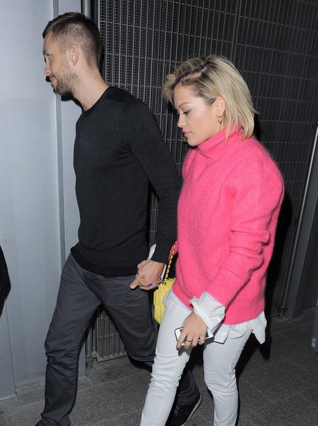 Calvin Harris and Rita Ora holding hands