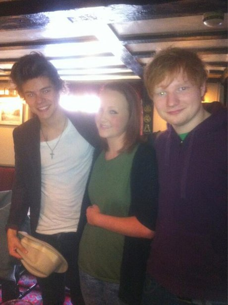 Ed Sheeran and Harry Styles with a fan