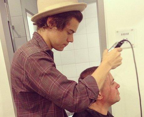 Harry Styles shaving someone's head on tour