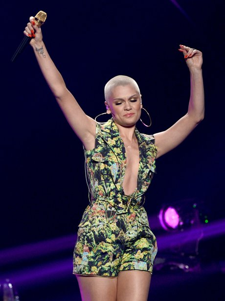 Jessie J holding her hands in the air on American Idol
