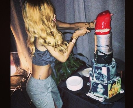 Rihanna cutting a cake on her world tour