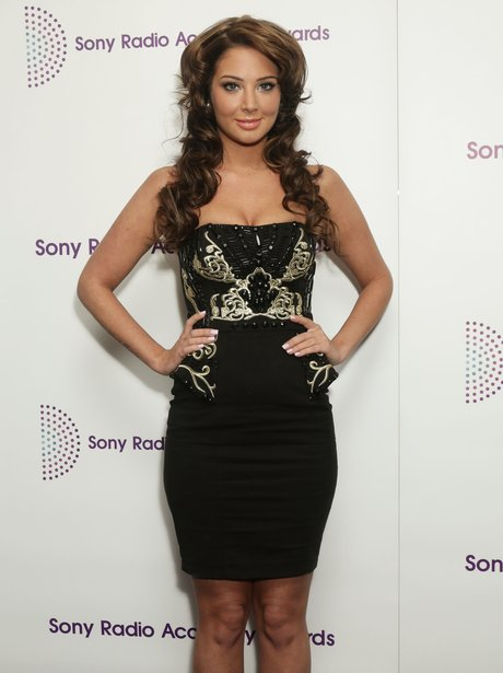 Tulisa with curly hair and black dress at the Sony Radio Acadey Awards