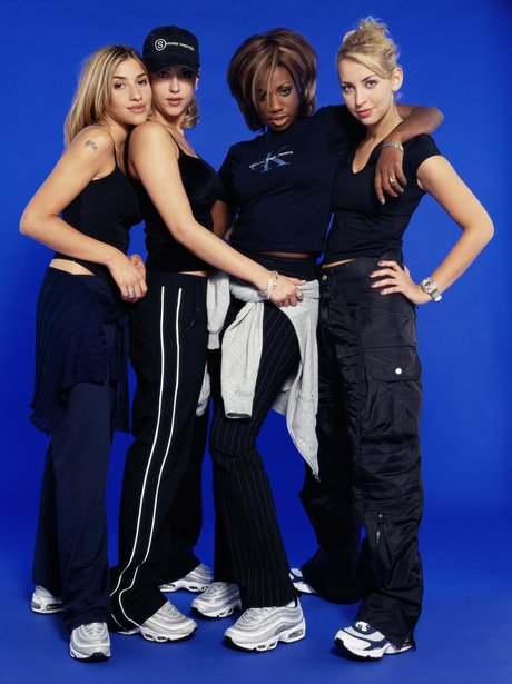 All Saints wearing baggy trousers in press shot