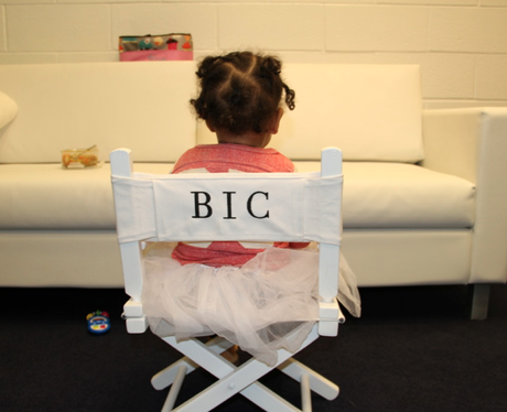 Blue Ivy Carter sitting in a chair