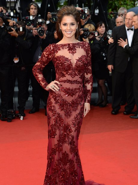Cheryl Cole wearing a red lace dress