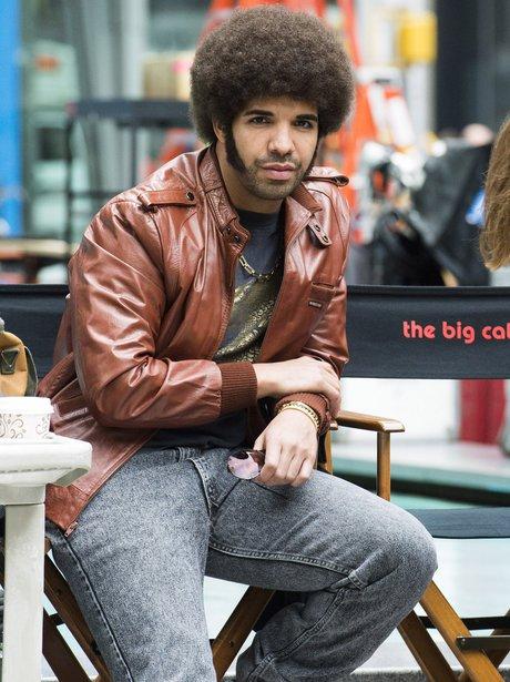 Drake wearing an afro wig while filming Anchorman