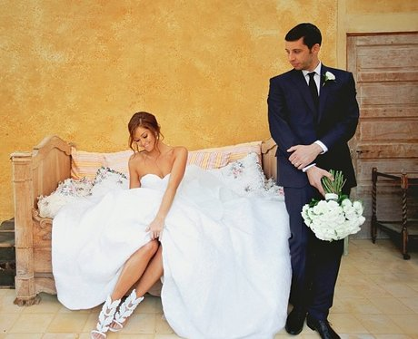 Example and wife Erin McNaught in their wedding outfits