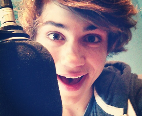 George from Union J speaking into a microphone