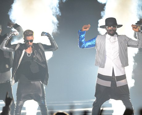 Justin Bieber and Will.i.am performing at the Billboard awards