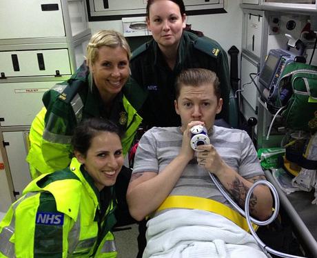 Professor Green in ambulance breathing oxygen