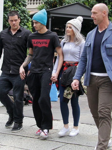 Zayn Malik and Perrie Edwards holding hands