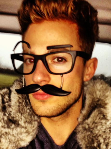 Adam Pitts gets kitted out in a fake moustache