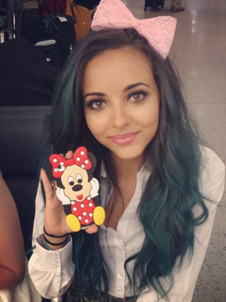 Jade Thirlwall holds up a Minnie Mouse toy