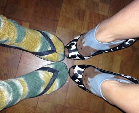 Katy Perry wearing flip flops and socks