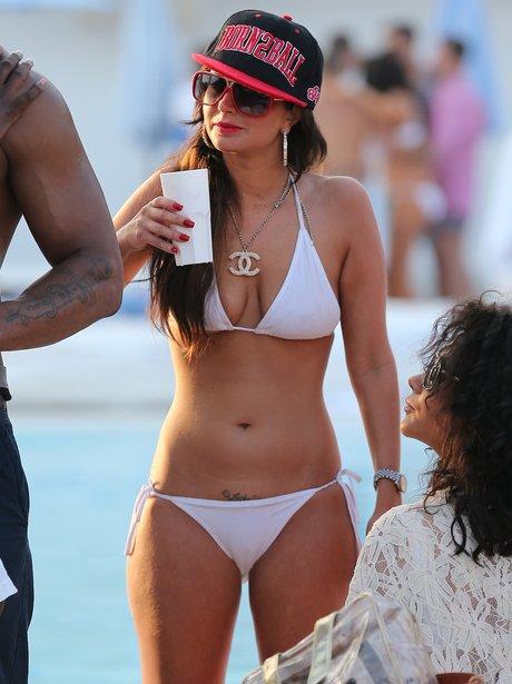 Tulisa Contostavlos wearing a white bikini while drinking
