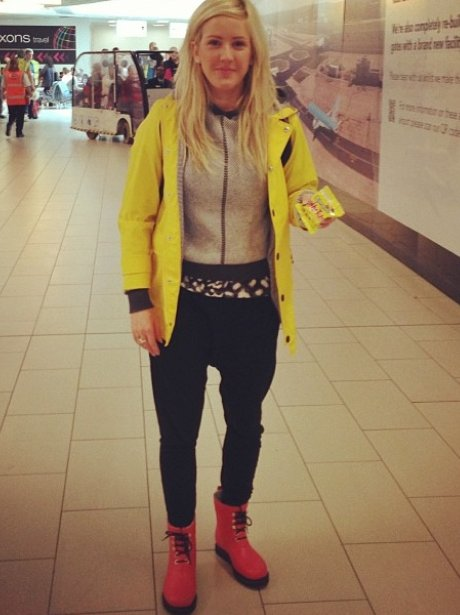 Ellie Goulding wearing a casual yellow jacket
