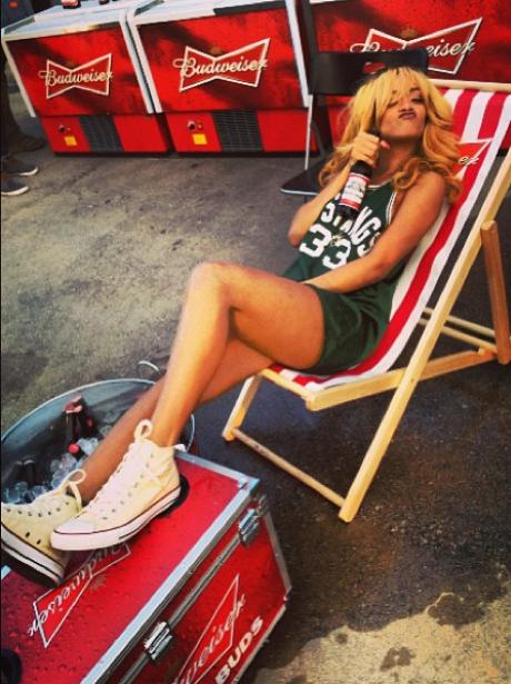 Rihanna relaxing on a deck chair