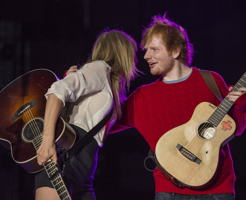 Surprise Taylor Swift Hugs Singer Ed Sheeran Before The Pair Perform A Duet For The Capital
