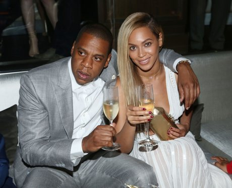 Beyonce and Jay-Z holding champagne glasses