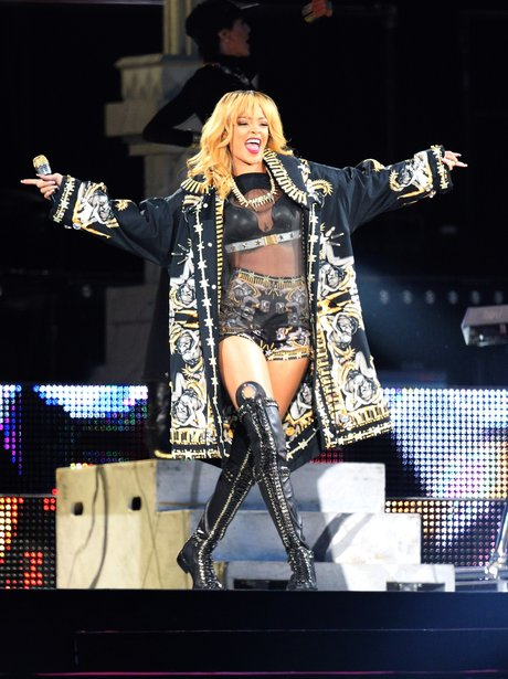 Rihanna with her arms out wide at Twickenham Stadium