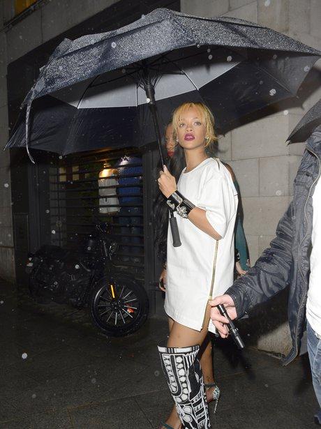 Rihanna holding an umbrella