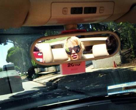 Rita Ora in a car