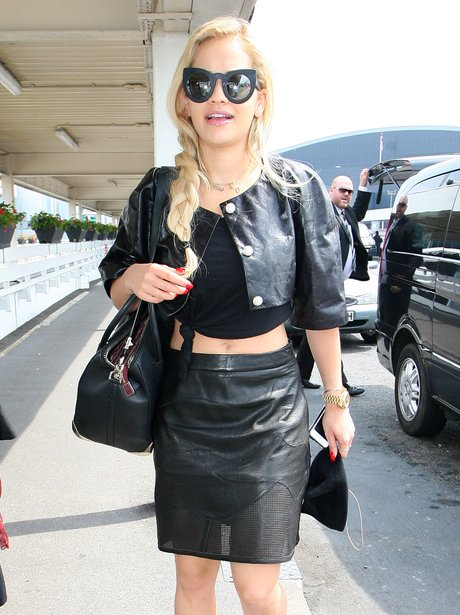 Rita Ora wearing leather jacket and dress