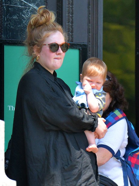 Adele with her baby Angelo wearing black