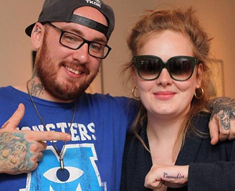 Adele shows off new paradise tattoo on her hand