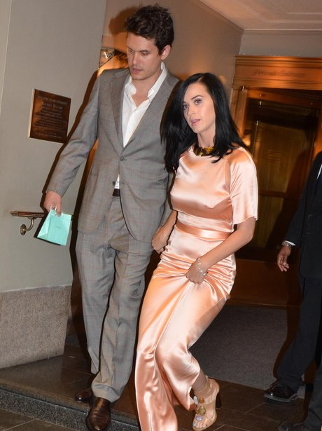 John Mayer and Katy Perry holding hands in satin pink dress