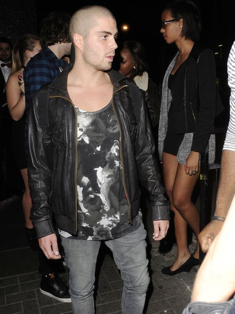 Max George wearing a leather jacket on a night out