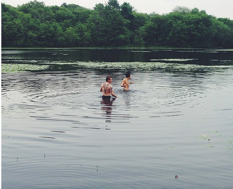 One Direction swimming in a lake