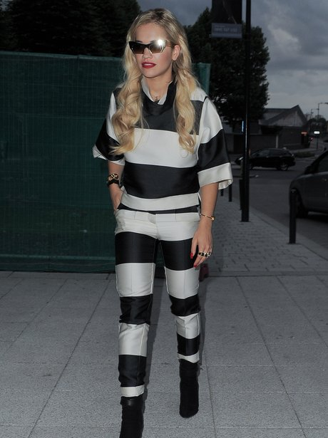 Rita Ira wearing a stripey outfit designed by Stella McCartney