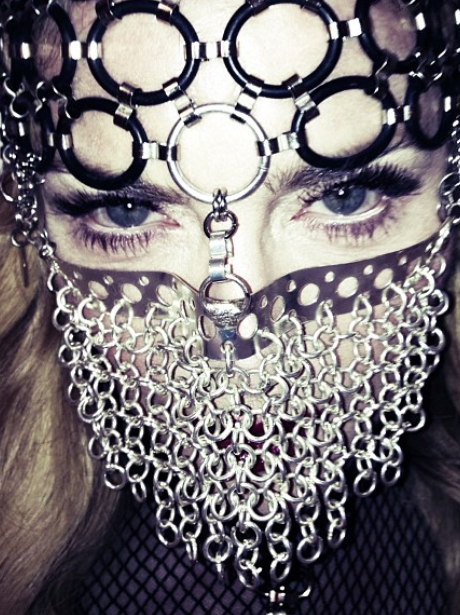 Madonna wearing a chain mask