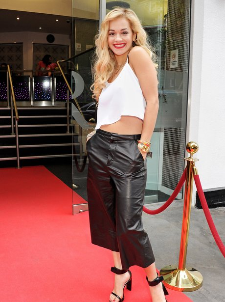 Rita Ora wearing leather trousers