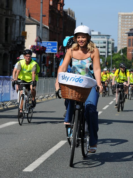 Kimberley Walsh riding a bicycle