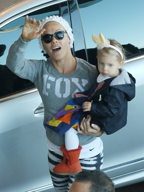 Pink carries her daughter Willow
